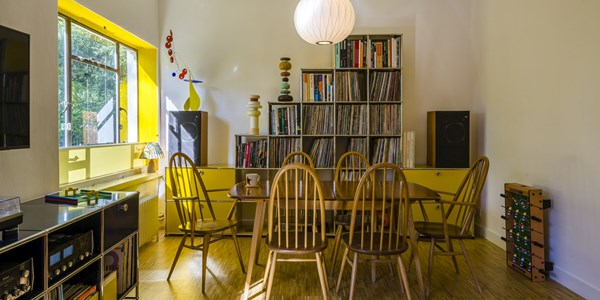 yellow USM Haller bookcase with vinyl storage
