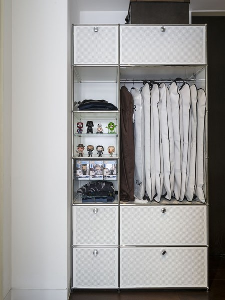 white USM Haller wardrobe with hanging storage and drawers and shelves for folded clothing