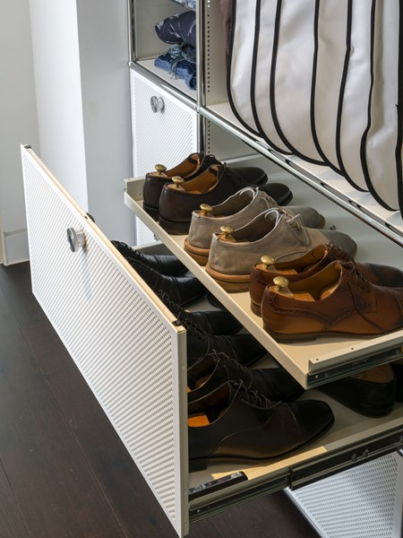 white USM Haller drawer for shoe storage in a wardrobe