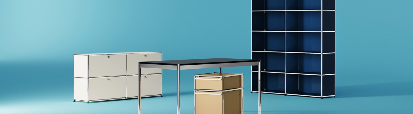 USM Haller suite of commercial furniture with shared workstation and lockable end of desk storage