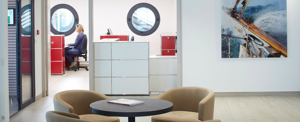 interior design incorporating branding with red and white metal sideboards