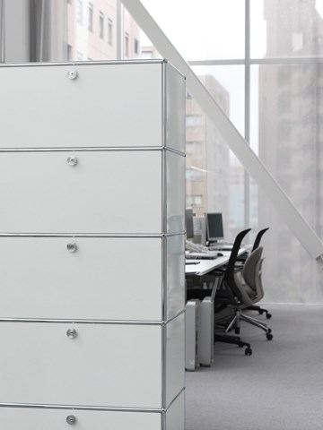 white and chrome USM haller office partition with storage cabinets in a contemporary office