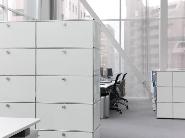 white metal USM Haller filing cabinets with in a bright office