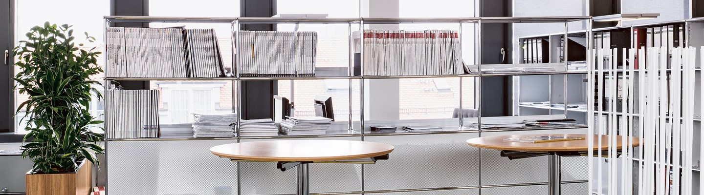 white USM haller office divider and bookshelves in an office library