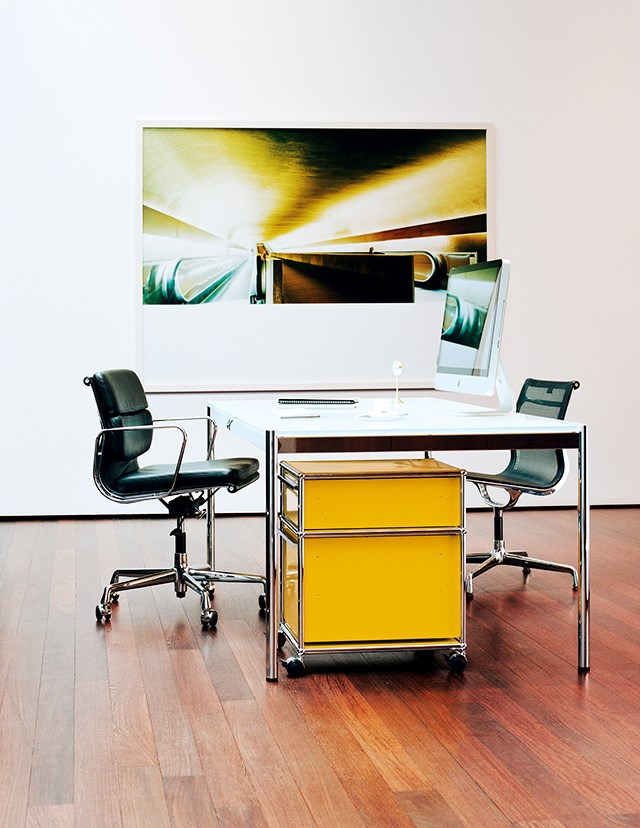 executive office with white USM Haller table and yellow storage pedestal