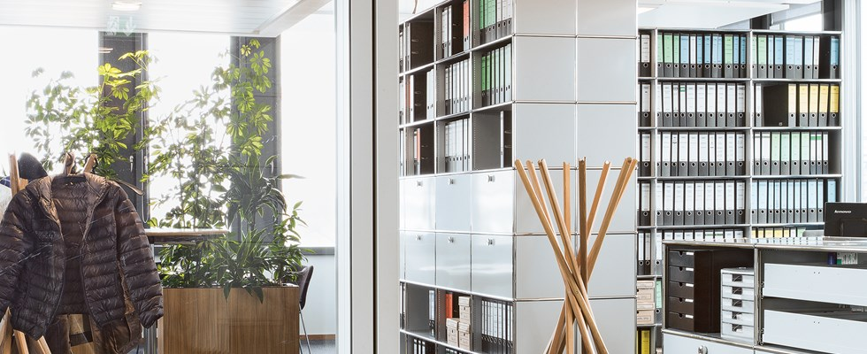 USM Haller filing cabinets and shelves in pure white in an open plan office