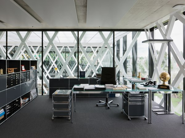 Black USM Haller storage cabinets and pedestal in a corner office