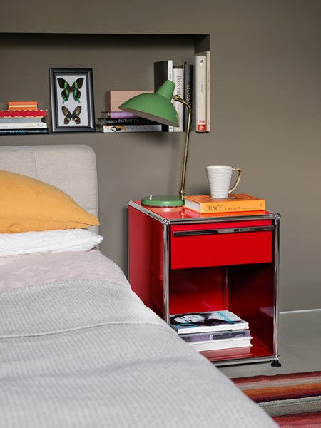 bedside table with drawer and open shelf in USM ruby red