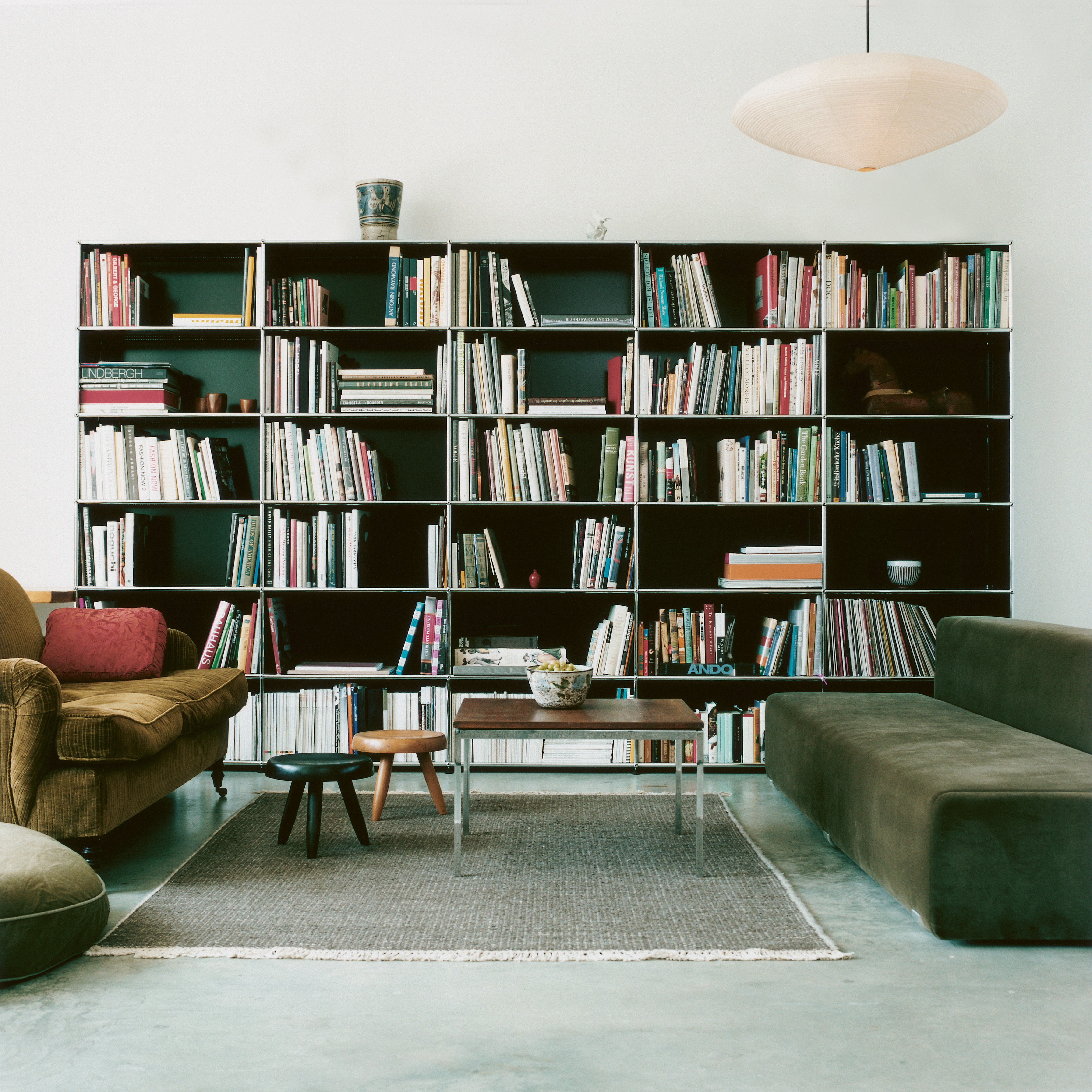 black USM Haller modular shelving in mixed style living room