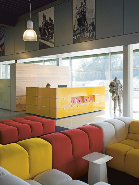 yellow USM Haller reception furniture in multicoloured foyer
