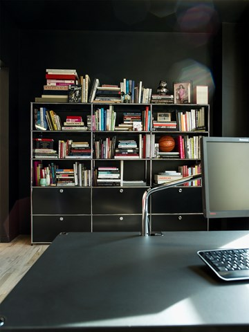 Black USM haller modular bookshelves and cabinets in an executive office