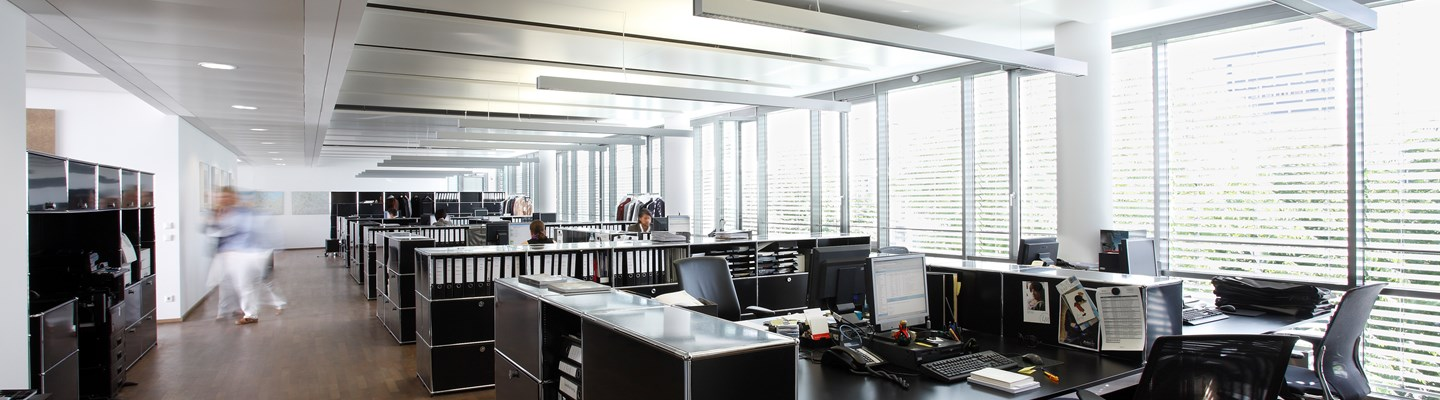 black USM Haller desks end of desk storage and pedestals in open plan office