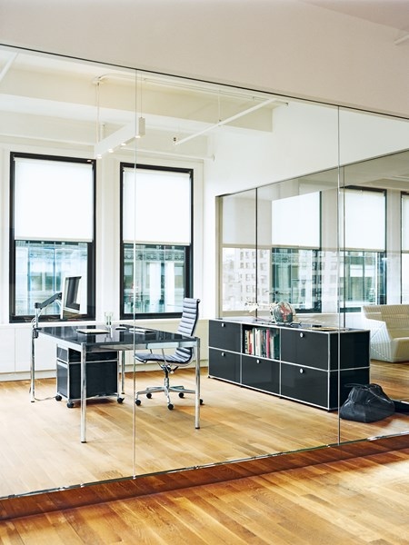 contemporary executive office with black USM Haller desk and sideboard
