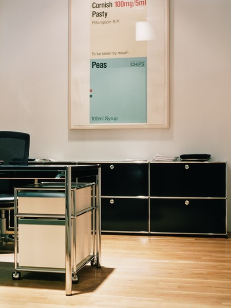 executive office with black USM Haller sideboard and white pedestal