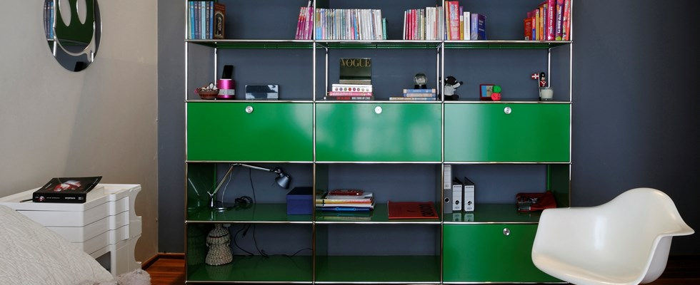green USM Haller book and toy storage in a child's bedroom