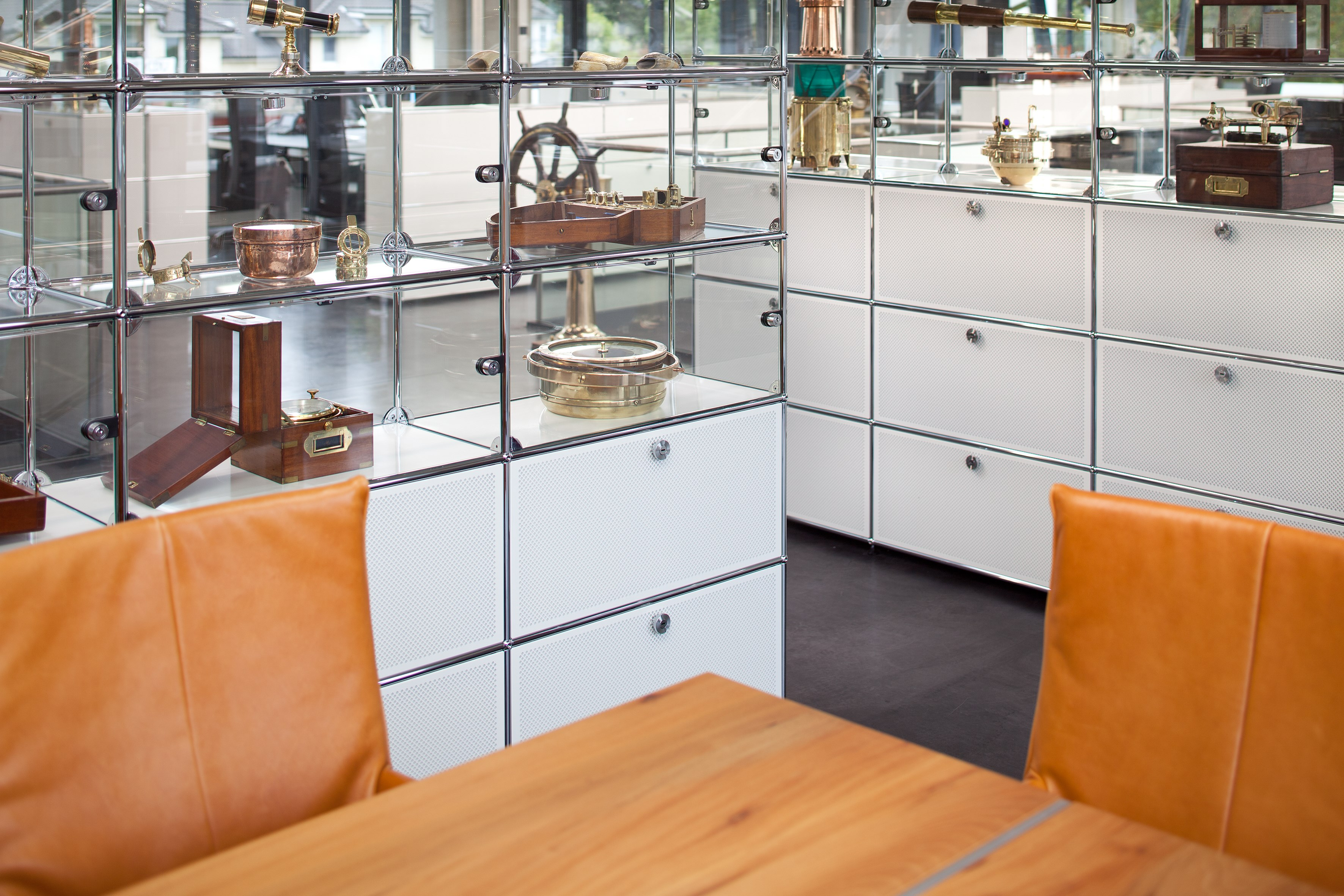 white USM Haller storage and display pieces with modern table and chairs