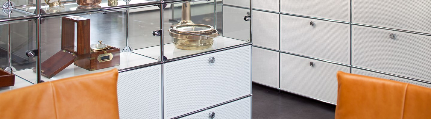 white metal USM haller storage cabinets with glass display