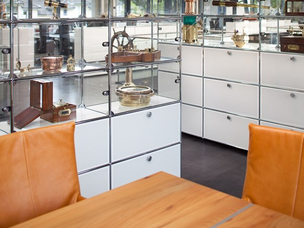 white USM Haller storage cabinet with glass display