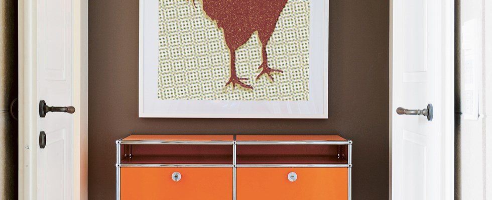 metal USM Haller reception table in orange in