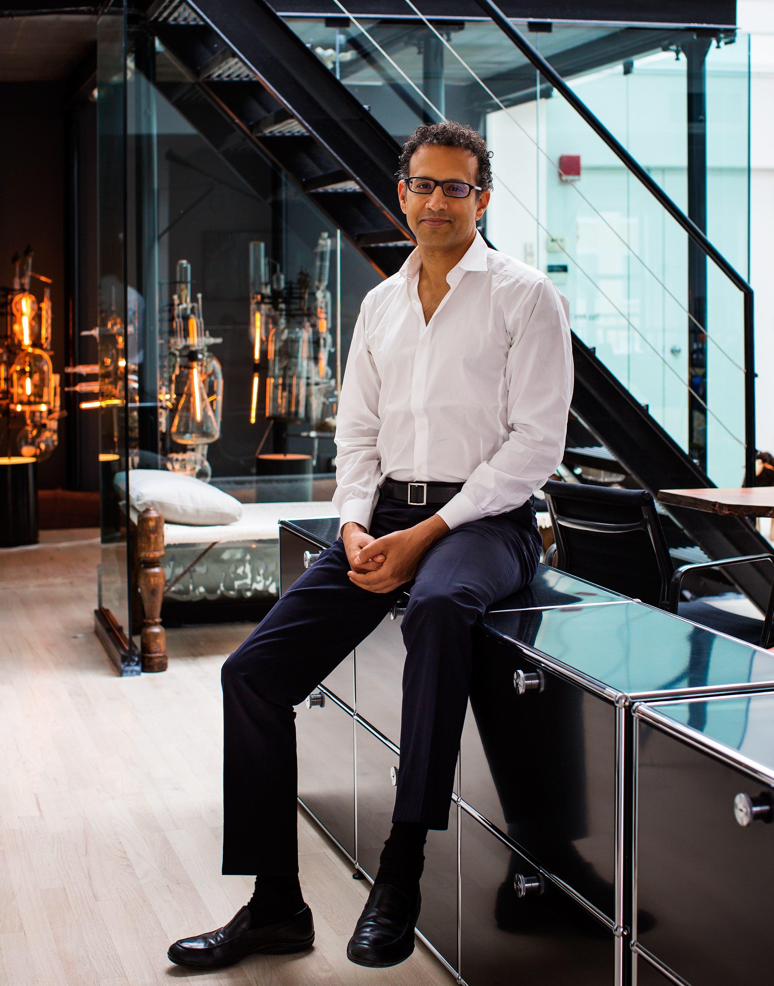 designer Ghiora Aharoni with his modern black USM Haller furniture