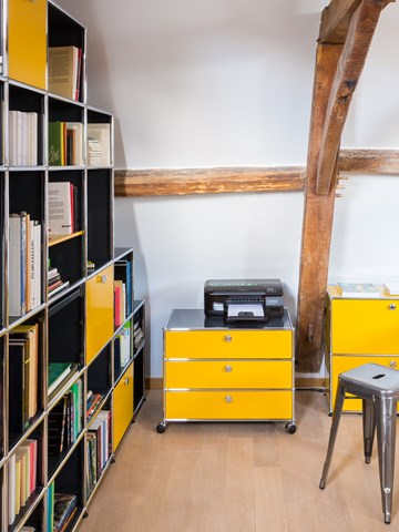 movable yellow USM Haller home office pedestal on castor wheels