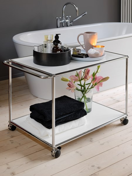 white metal USM haller serving trolley in a wooden floored bathroom
