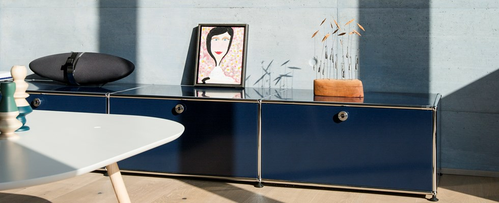 metal blue USM haller sideboard storage with chrome in a modern livingroom