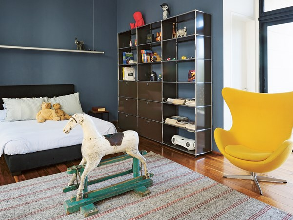 Brown USM Haller shelving for modern children's room