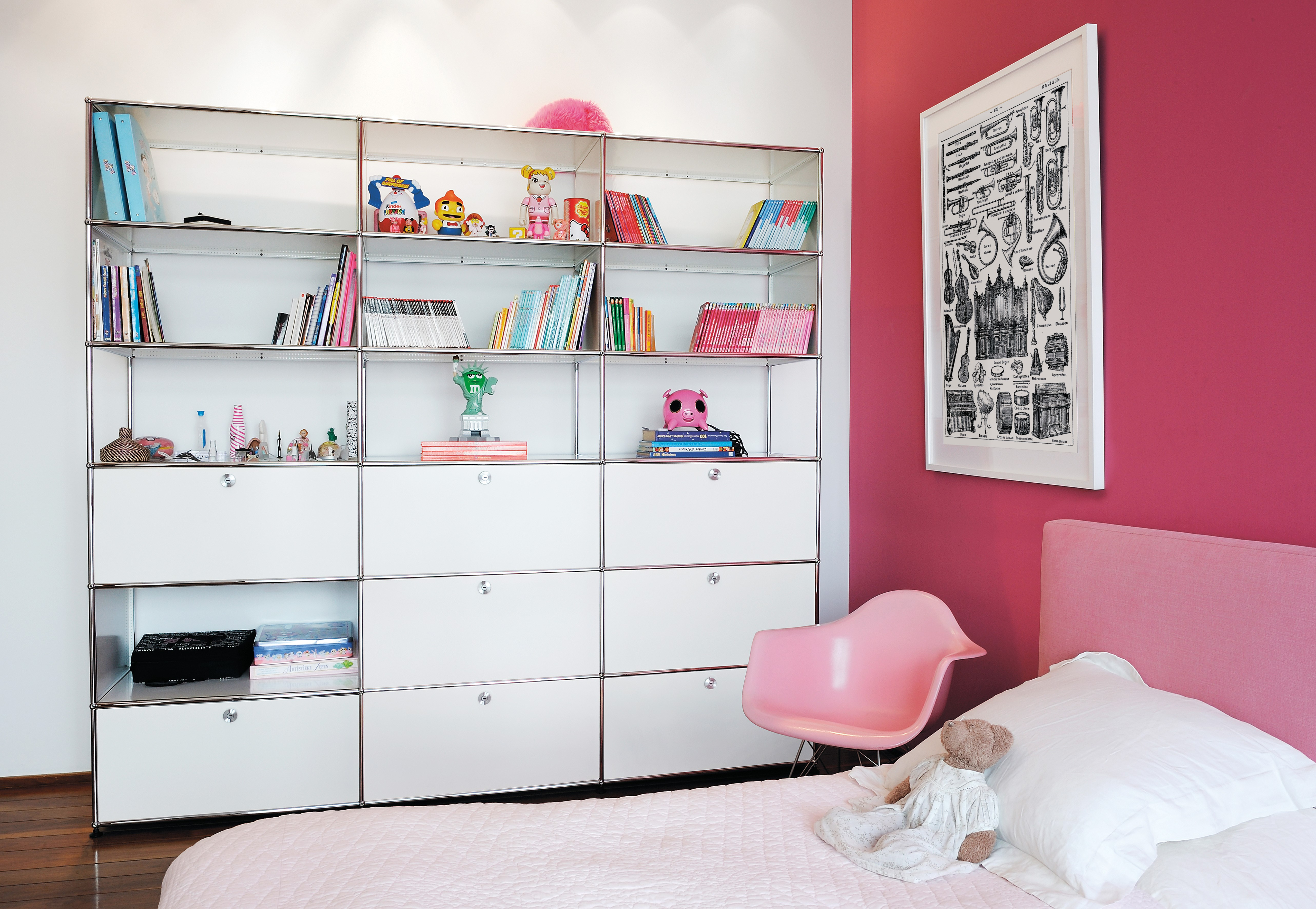 pure white metal USM haller bookshelves and storage in a child's bedroom