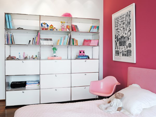 white USM Haller shelving with drawers in pink child's bedroom