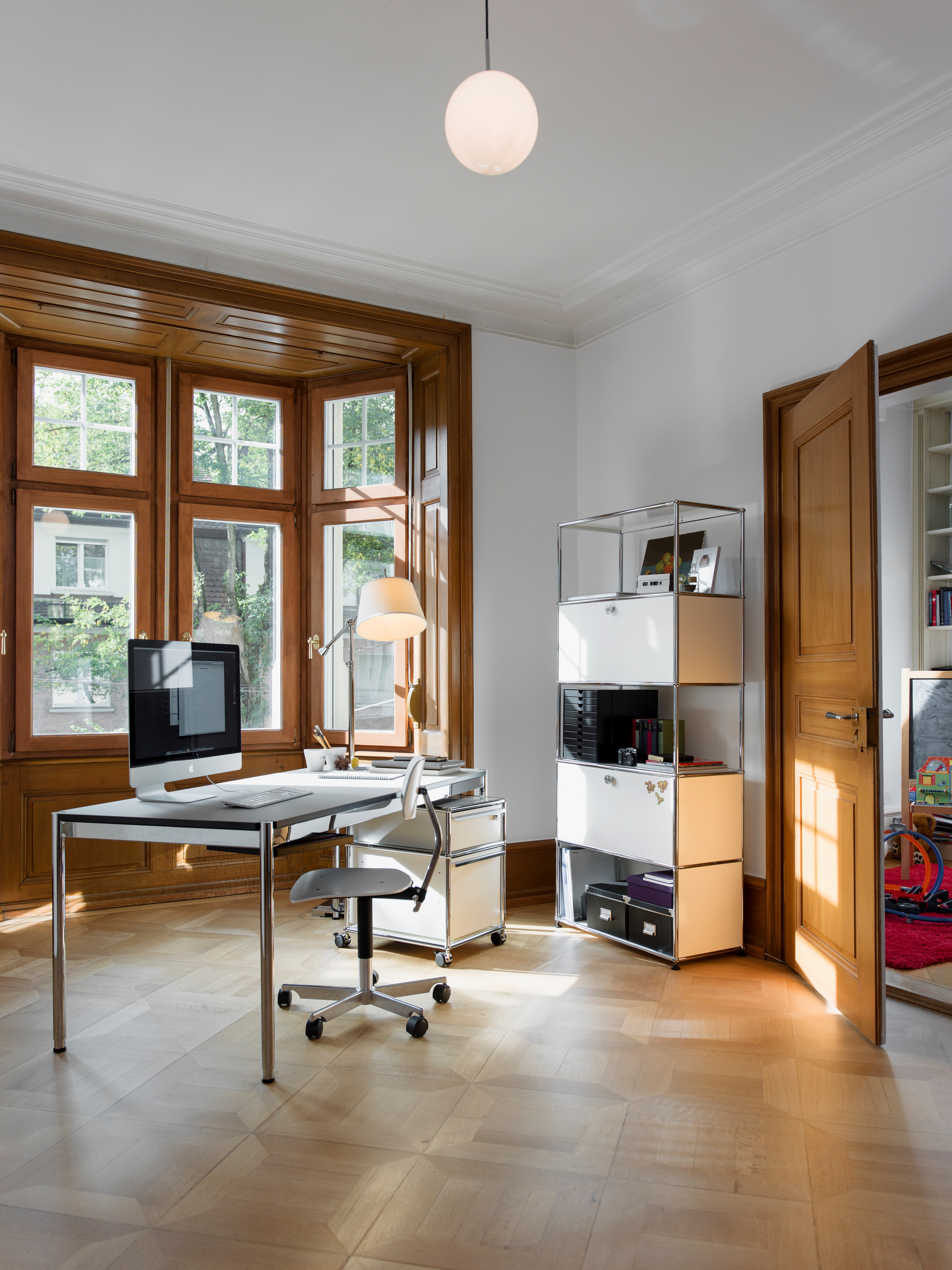 white USM Haller file storage and pedestal with table in modern home office