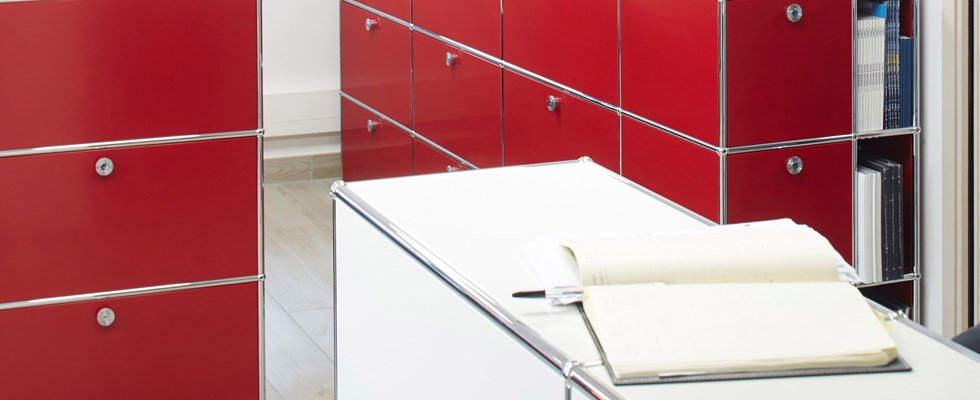 elegant designer office furniture in USM Haller ruby red and pure white
