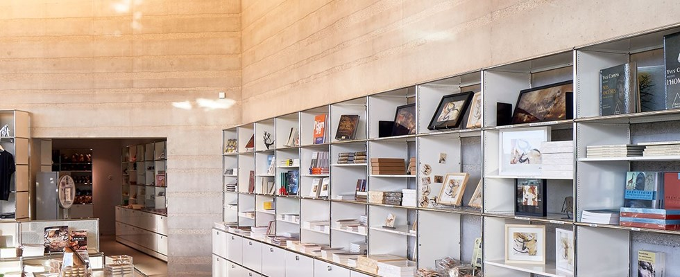 white USM Haller museum display shelving with modular display cabinets
