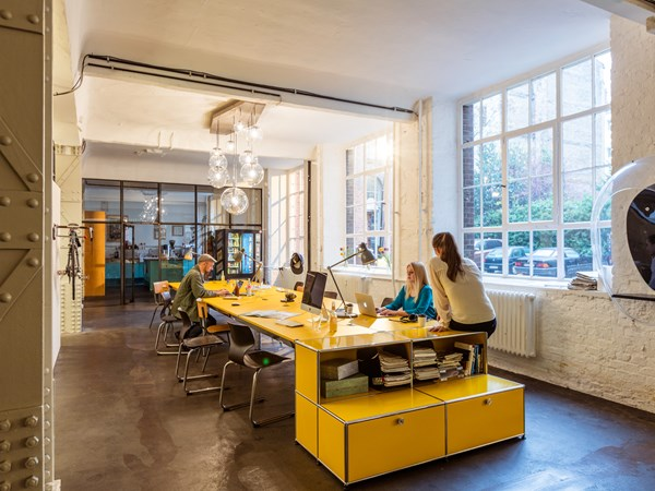 USM Haller meeting table in golden yellow with matching storage