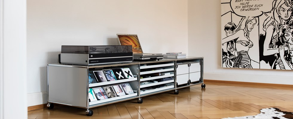 white USM Haller media unit with extendable shelves and CD trays