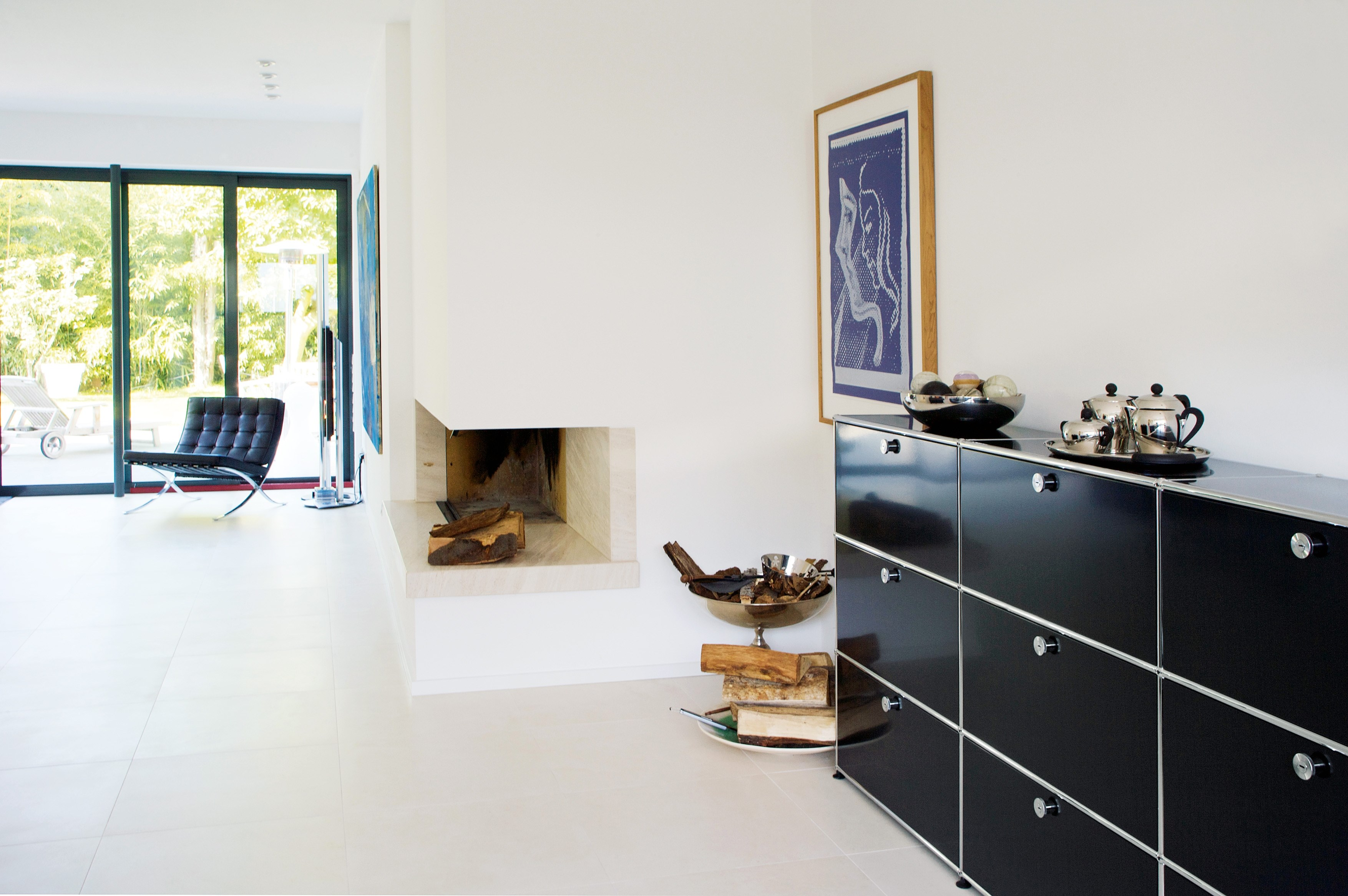 graphite black sideboard storage in an all white livingroom