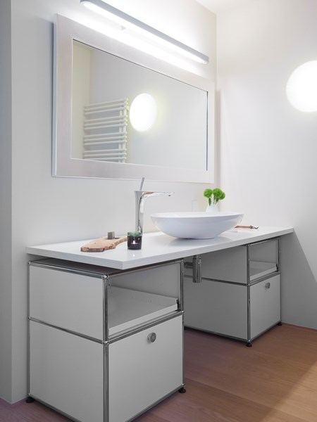 pure white USM haller shelving and storage in a white bathroom