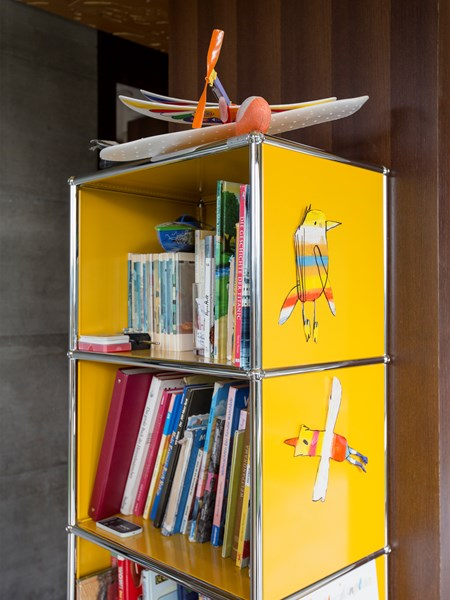 USM Haller shelving in a child's room with toys and books