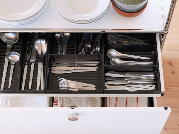 white USM Haller kitchen unit with drawer organiser for cutlery