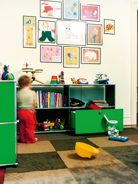 USM Haller green modular storage for a kid's room