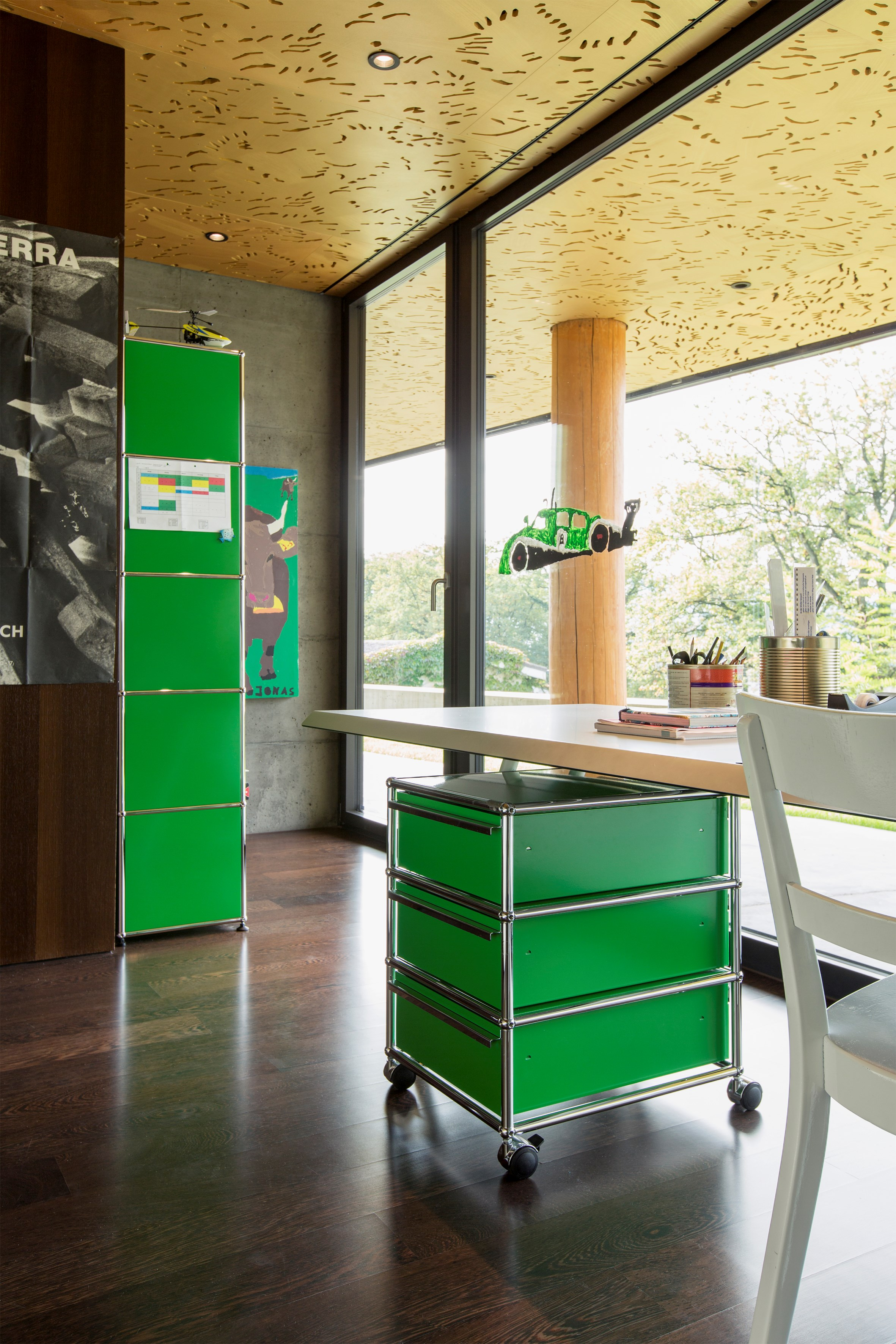 green usm pedestal and storage shelves in a childrens rooms