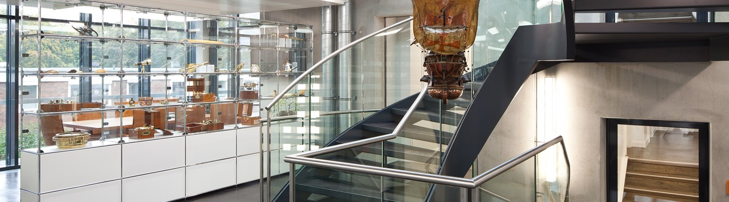 modern museum stairwell with white USM Haller furniture