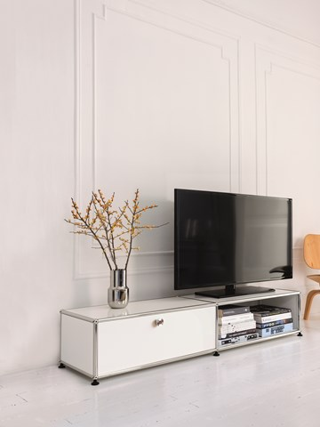 white USM tv unit and storage in a contemporary white living room