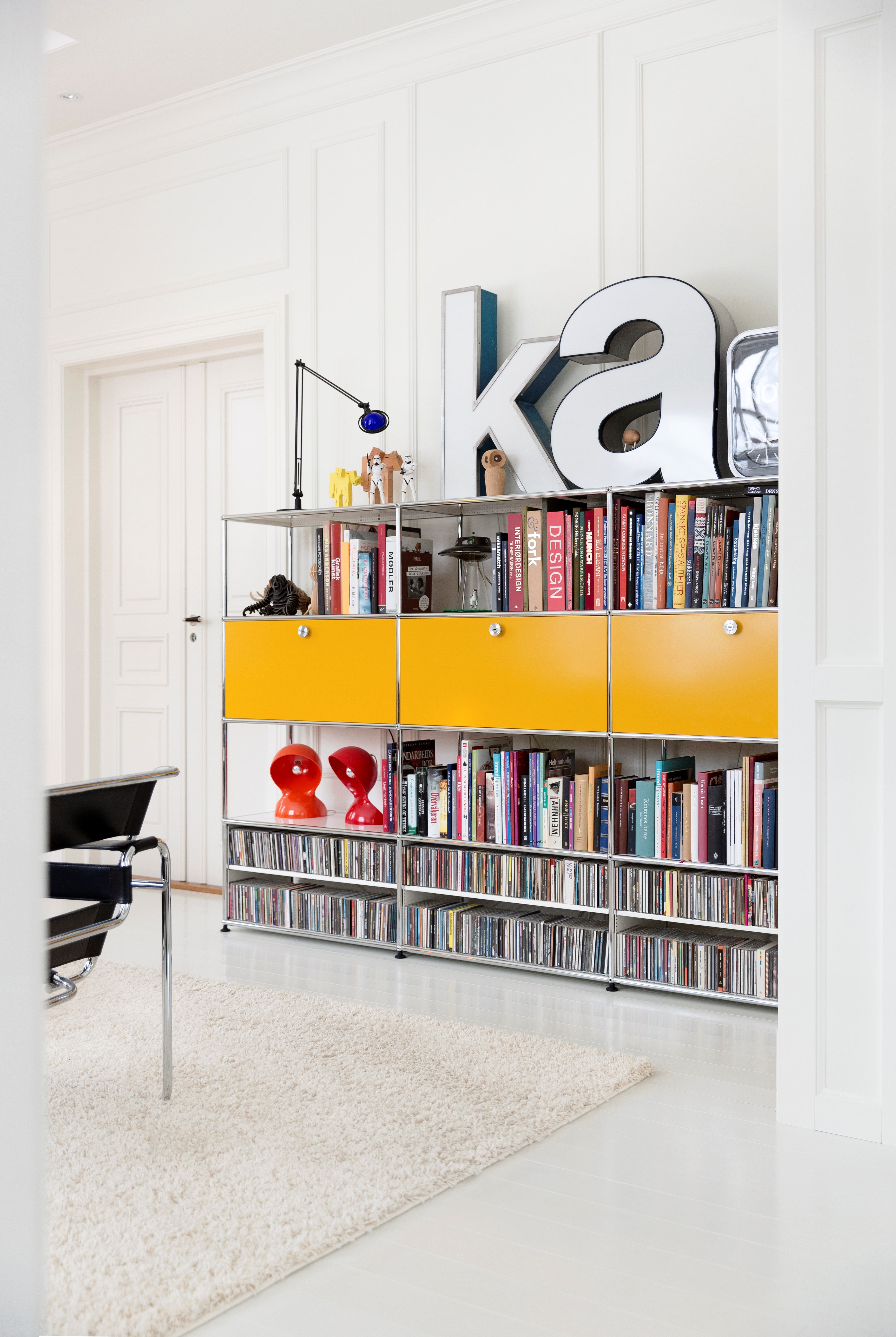 yellow USM Haller living room shelving for books and CDs