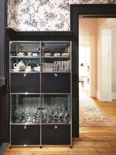 black USM Haller kitchen unit with glass display pieces in modern home