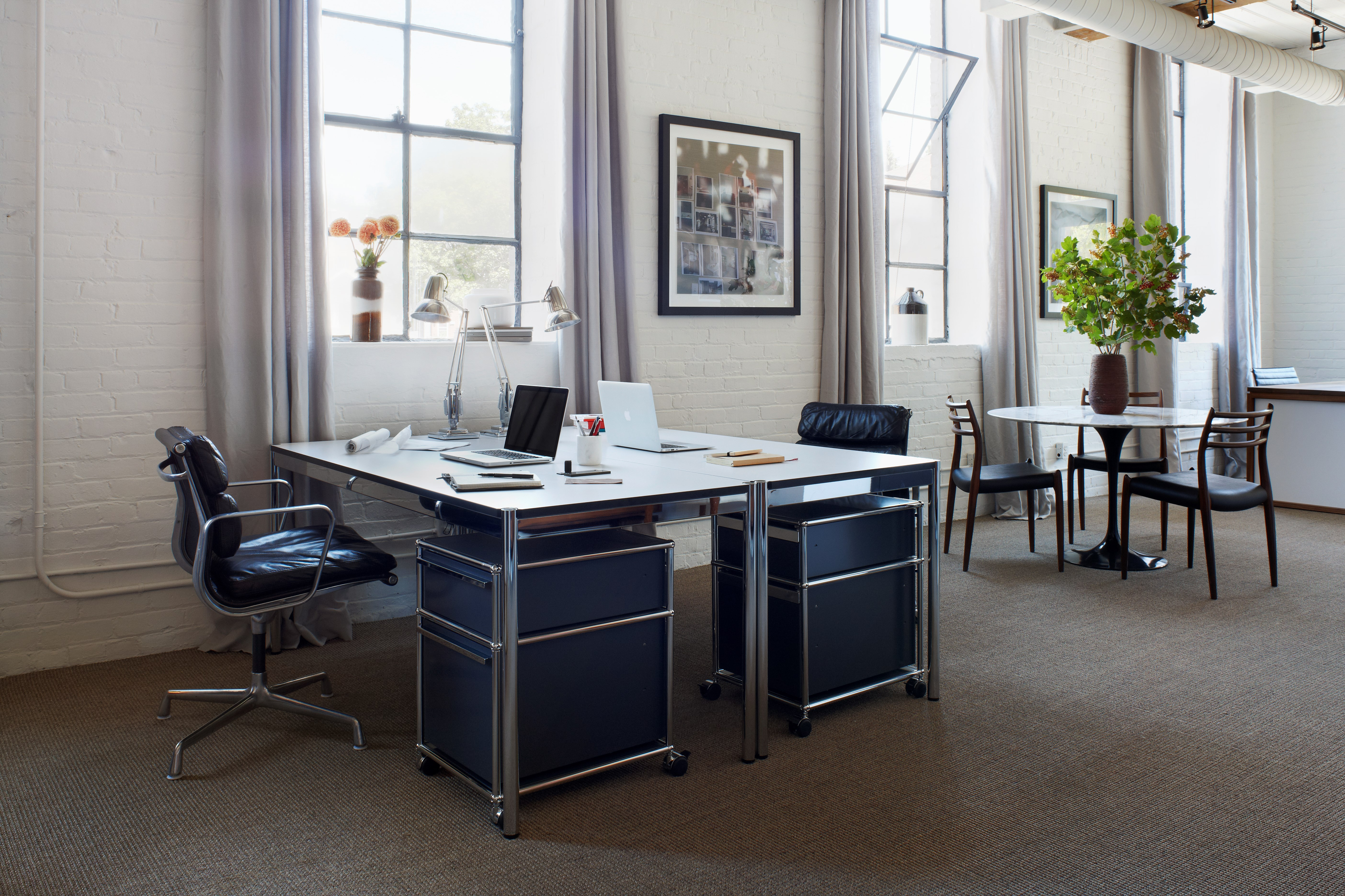 home office design with minimalist grey workstations and leather chairs