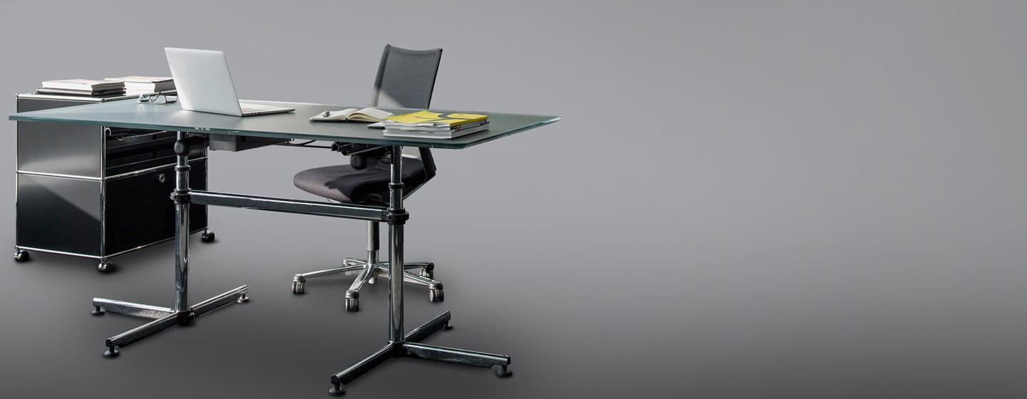 classic USM Kitos executive office table with glass and chrome finish