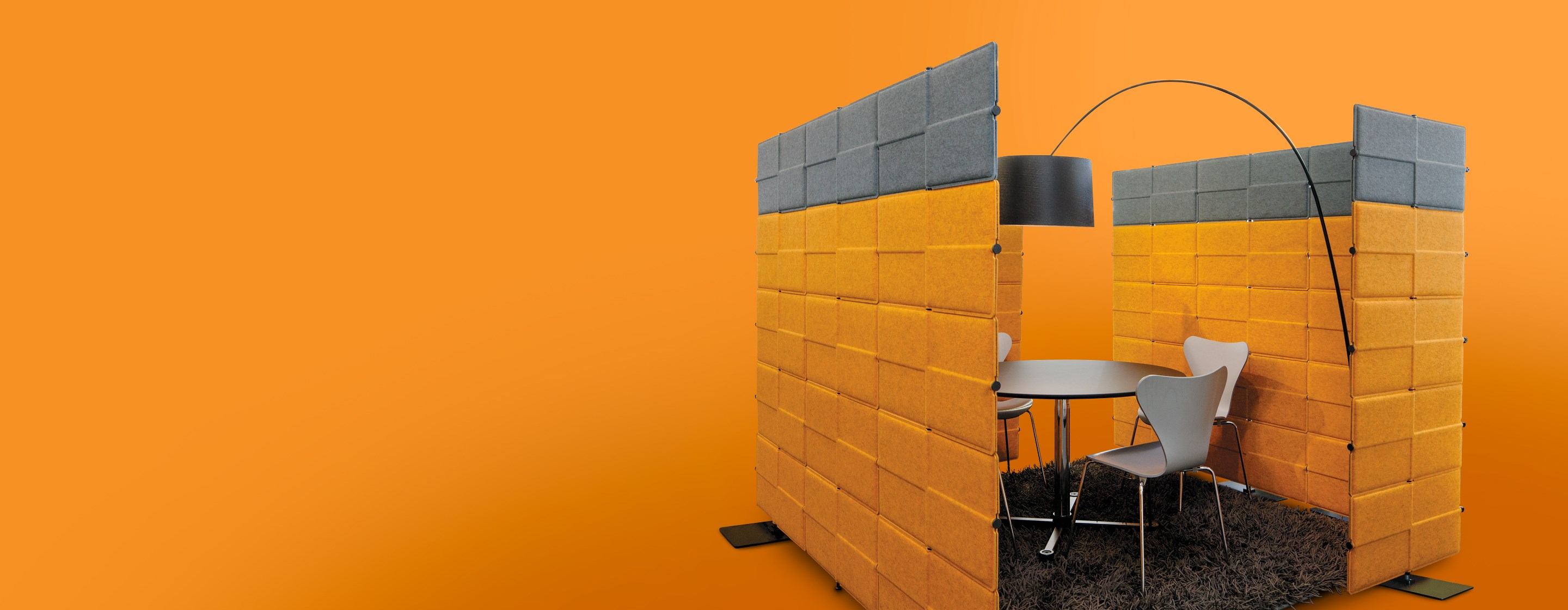 orange and grey acoustic USM Privacy Panels in a modern office breakout area