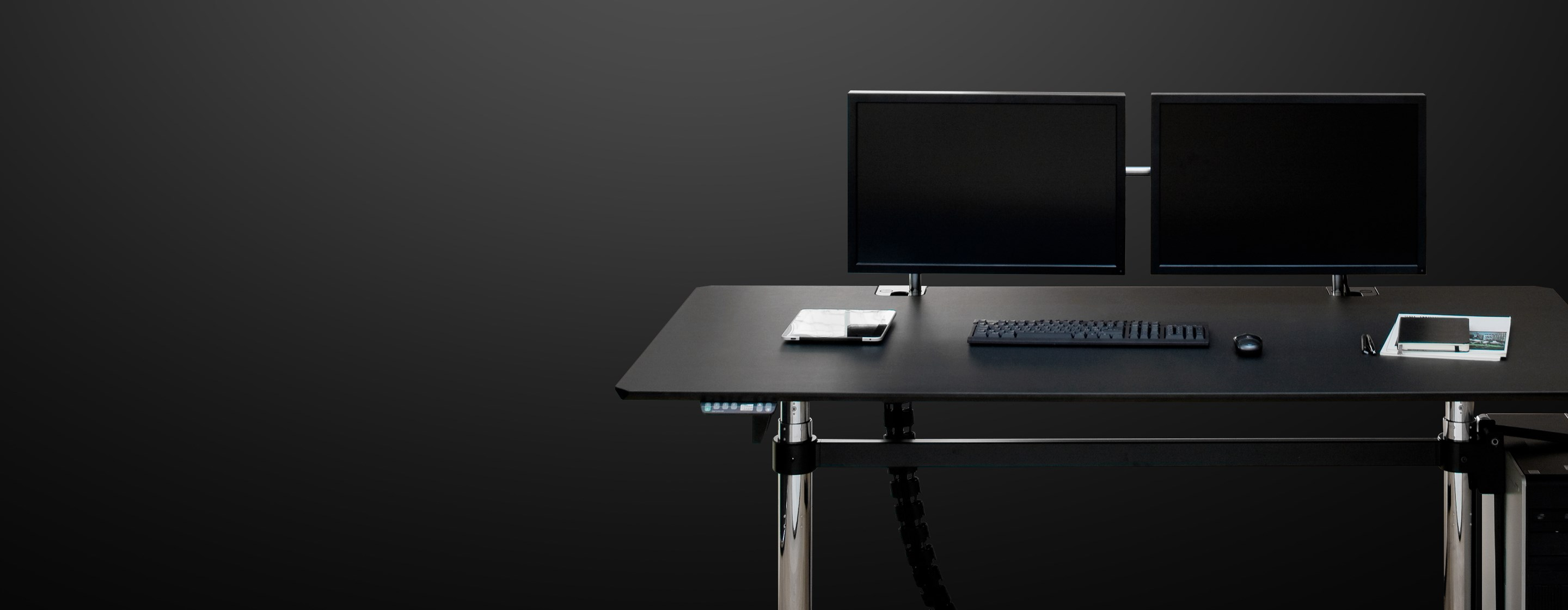 minimalist black and chrome workstation with height-adjustable USM Kitos E