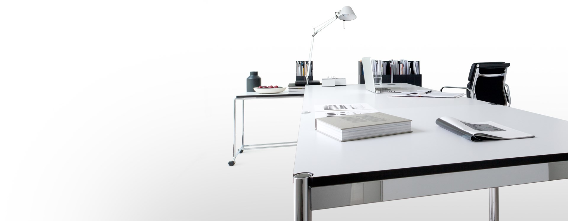 USM Haller modern desk table with moveable side table on castor wheels